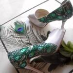 Оформление свадьбы перьями павлина